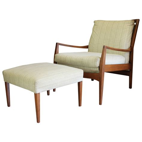 mid century modern teak lounge chair and ottoman at