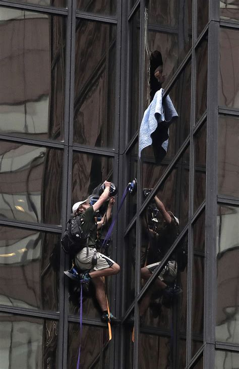 man is trying to scale trump tower on fifth avenue in nyc police grab man climbing trump tower in new york city