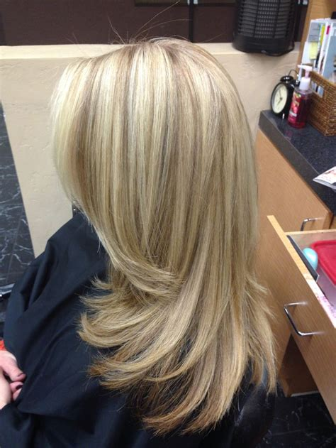 hi and low lights on layered hair long blonde hair long layers low lights highlights by