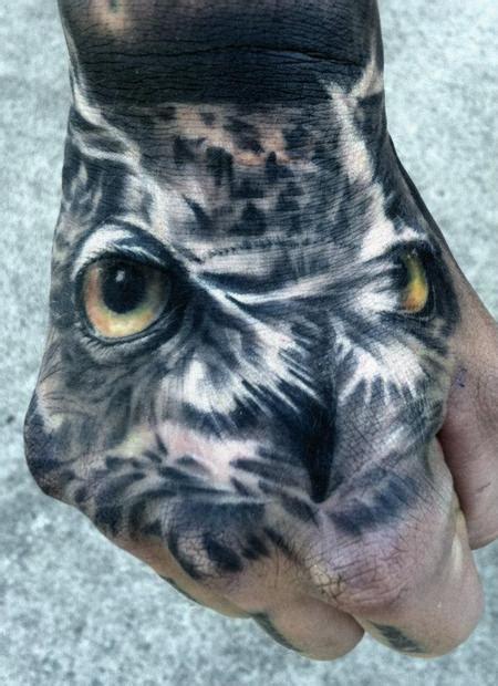 owl tattoo on hand realistic owl hand tattoo by dean lawton tattoonow