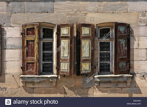 brownstone house historic windows with shutters detailed view of a