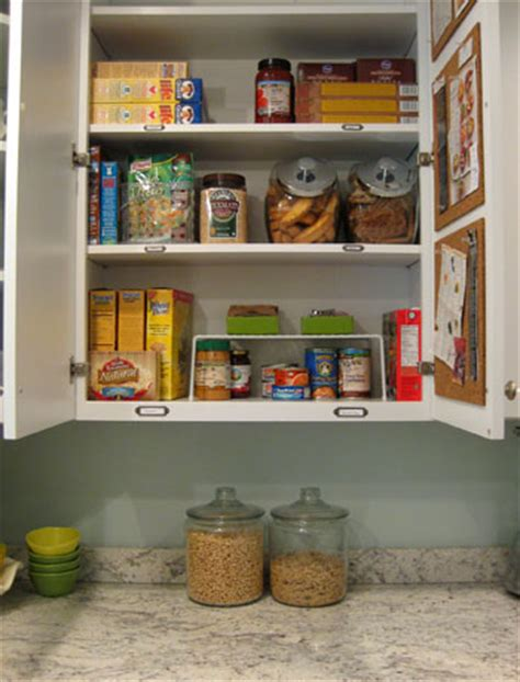 organization for kitchen cabinets organizing our kitchen cabinets spices pantry items