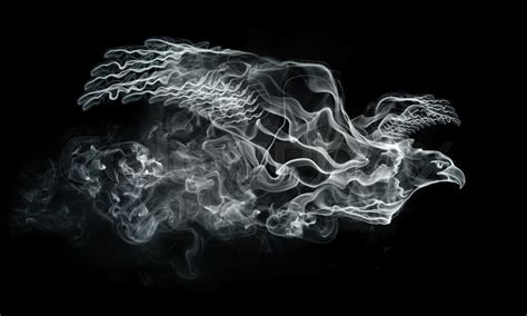 smoke eagle isolated on the black background computer