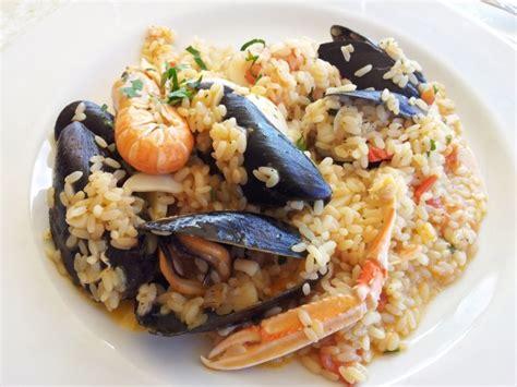 come si cucina il risotto ai frutti di mare ricetta risotto ai frutti di mare piatto ricco e