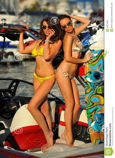 hot young bikini models posing   sport speed boat