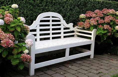 white lutyens garden bench white lutyens bench seat flanked by white flowering