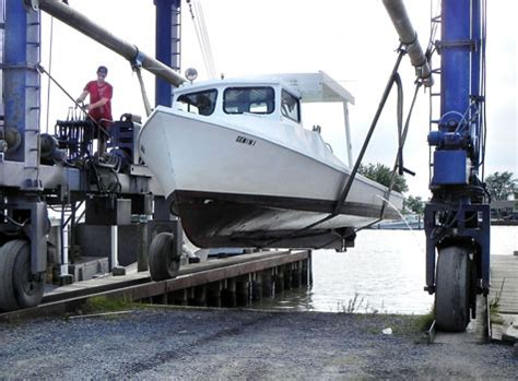 boat lift hurricane preparation watermen quit crabbin and haul out workboats local