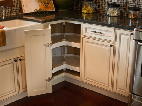 rotating shelves kitchen cabinets a corner door opens to reveal a kidney shaped lazy