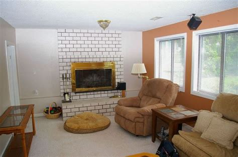 would you paint your brick fireplace a bold orange we did hometalk