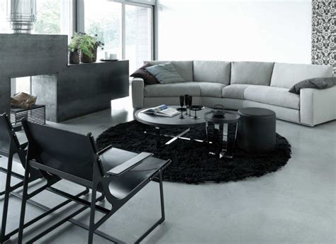 area rugs with grey couch how to make a statement with black and white rugs