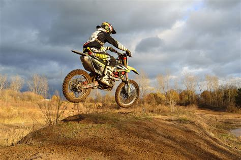 how to jump a motocross bike motocross rider on his dirt bike during daytime 183 free