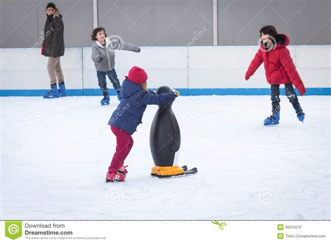 people skating on ice rink in milan italy editorial