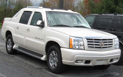 white cadillac escalade ext 301 moved permanently