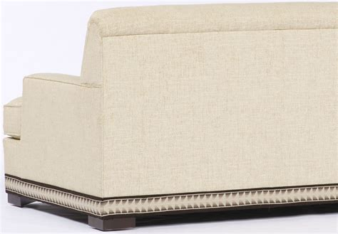 ottoman with nailhead trim cream sofa with nailhead trim