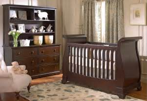 Wall crib matches dresser with shelving in this cozy nursery pink