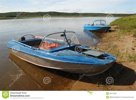 motor boat z two motor boats on the shore royalty free stock image