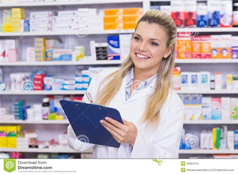 Pharmacy Intern by Pharmacy Intern Writing On Clipboard Stock Photo Image