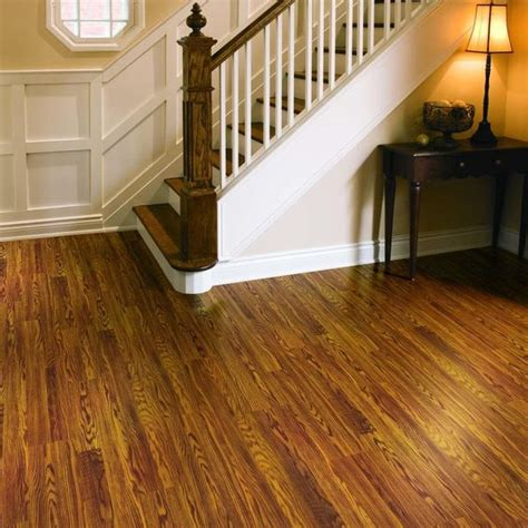 gunstock oak floors and stair treads with white spindles and molding decorating ideas