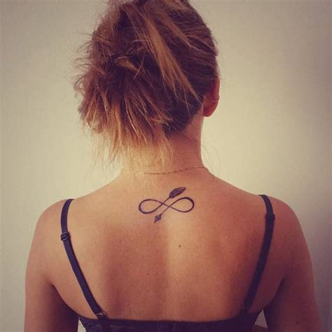 infinity tattoo back of neck tumblr infinity arrow tattoo on veronika s upper back small