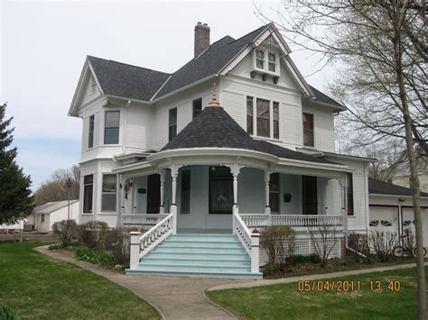 Victorian Farmhouse Style | beautiful white eastlake queen anne victorian style house