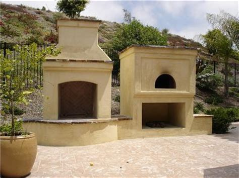 outdoor fireplace and oven with stucco garden