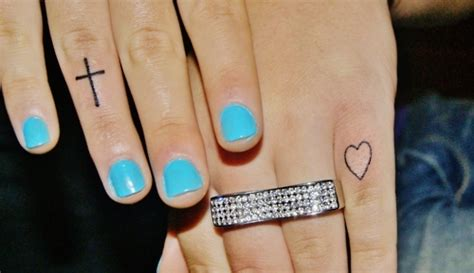 cute cross tattoos tumblr cross on finger www imgkid the image