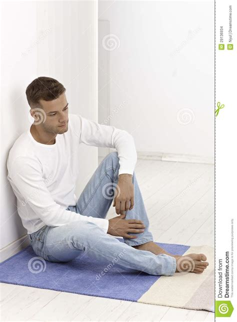 Sitting On by Sitting On Floor Looking Sad Stock Photo Image