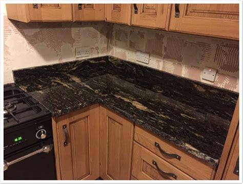 Titanium Granite Countertops With White Cabinets by Titanium Black Granite Denver Shower Doors Denver