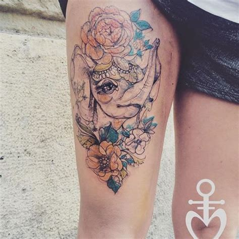 elephant tattoo upper thigh sketch style colored thigh tattoo of elephant with flowers
