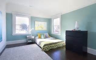 Tranquil blue green color balances the white trim and dark floors in