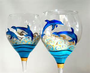 Blue dolphins wine glasses hand painted by skyspiritstudios