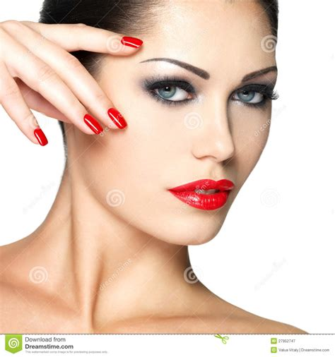 make beautiful beautiful woman with red nails and fashion makeup stock