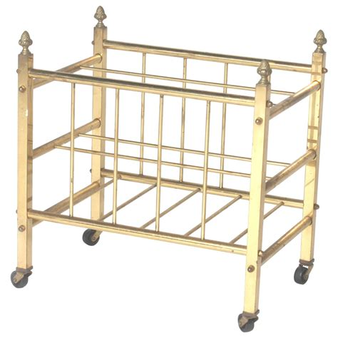 brass magazine rack with wheels circa 1940 for sale at