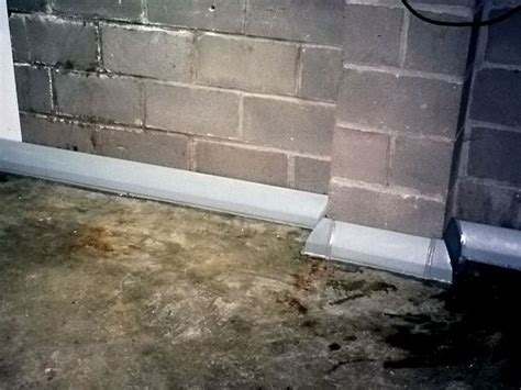 baseboard basement drain pipe system in greater des moines