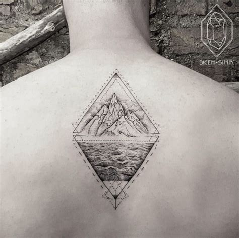 tattoo chest triangle geometric mountains in triangle tattoo on man upper back