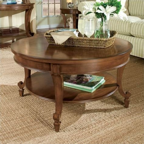 round wood cocktail table aidan round wood cocktail coffee table in cinnamon brown