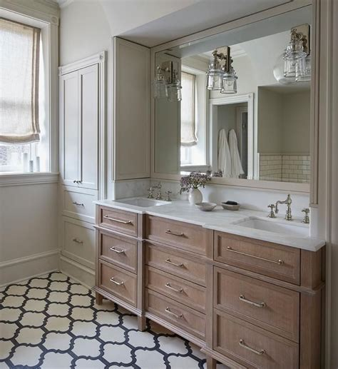 charming bathroom boasts  brushed oak dual vanity