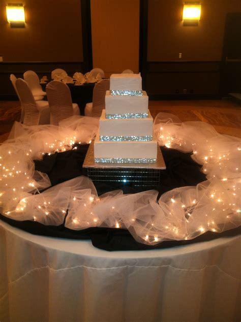 4 tier square presentation cake with rhiinestone cake