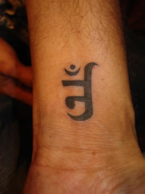 om symbol tattoo wrist 25 best jain tattoos