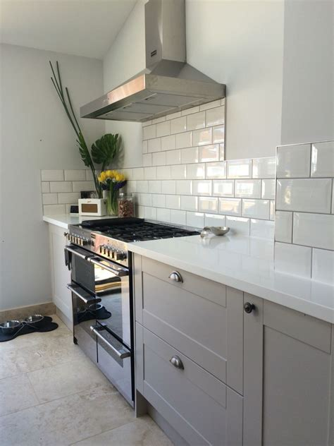 corian tile grey burford kitchen with white corian worktops and subway