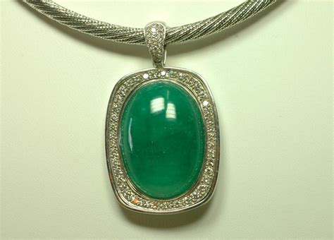 emerald pendant studded with diamonds jewelry