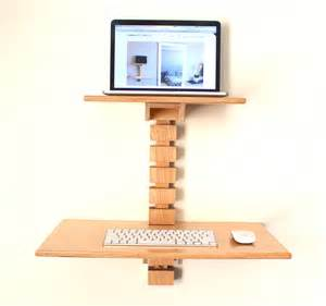 Wall mounted standing desk laptop wooden for saving spaces on white