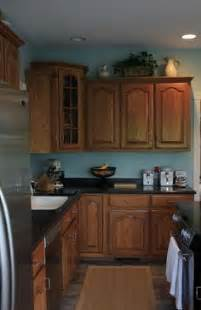 blue kitchen walls with oak cabinets