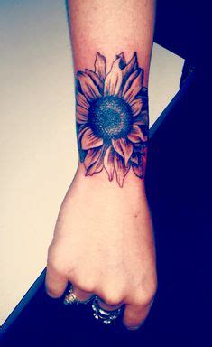 sunflower and cherry blossoms forearm tattoo by kylie wild