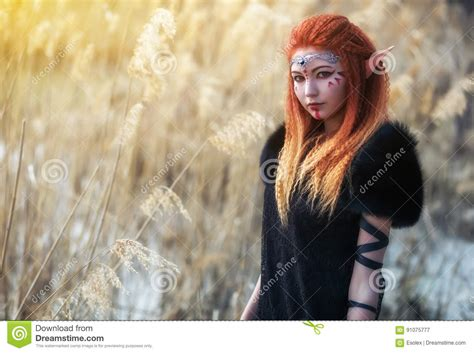 female elf white hair cosplay elf women with fiery hair on nature stock image image