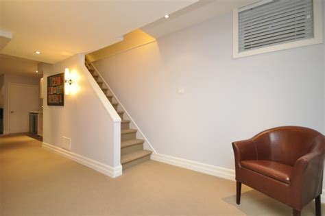 half wall staircase completed work by menage transitional basement other