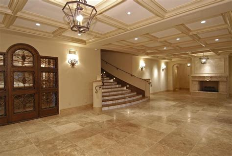 like a room porcelain tile that looks like travertine living room mediterranean with coffered ceiling