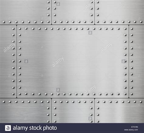 Metal Plate metal plates with rivets background stock photo royalty