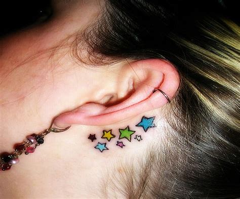 star tattoo behind ear