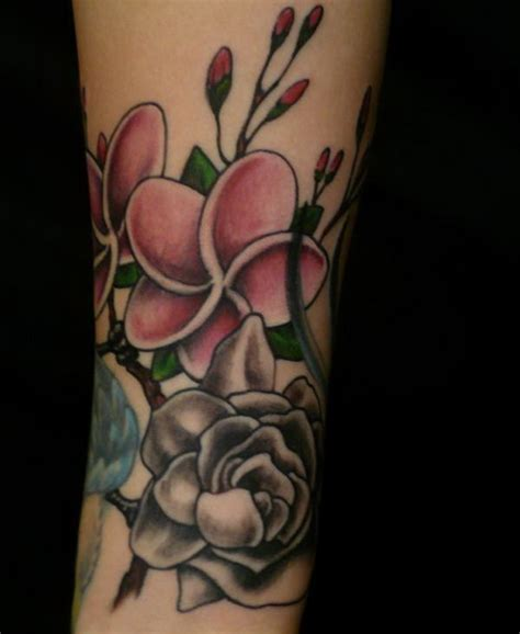 hidden hand tattoo flower